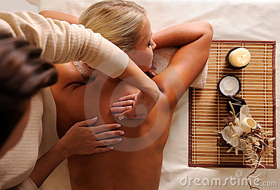 Female getting relaxation massage in beauty salon