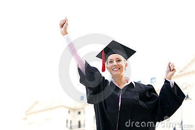 Female graduate clenching fists