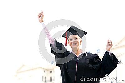 Female graduate clenching fists