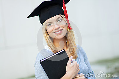 Female graduate holding book