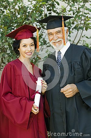 Female Graduate Holding Certificate With Dean