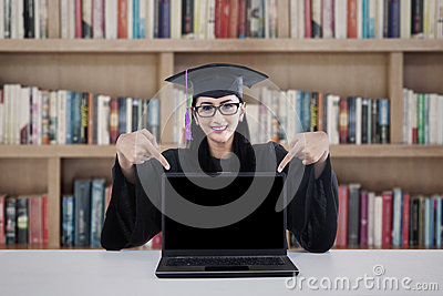Female graduate student pointing at copyspace