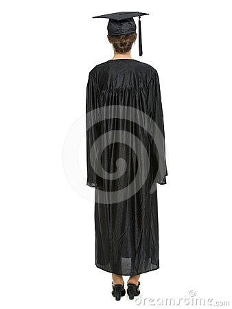 Female in graduation cap and gown standing back
