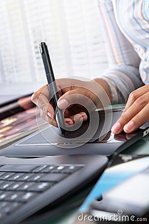Female graphic designer using tablet pen
