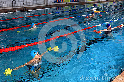 Female group training in the indoor swimming pool, editorial use Editorial Photo
