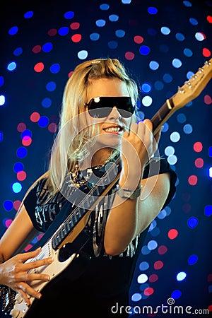 Free Female Guitar Player Stock Photos - 7095313