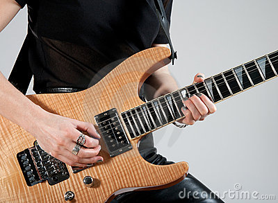 Female guitarist playing electric guitar