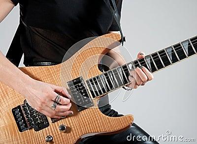 Female guitarist playing electric guitar