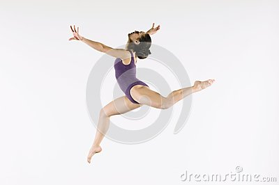 Female Gymnast Leaping In Air