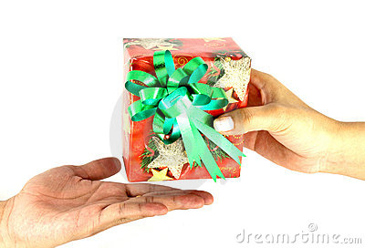Female hand give a christmas present