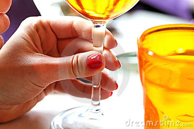 Female hand with glass of wine