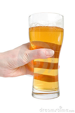 Female hand hold glass of lager beer