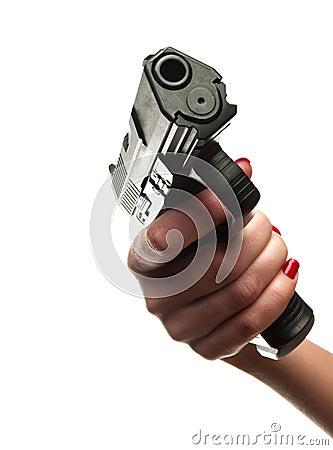 Female hand holding 9mm handgun