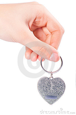 Female hand holding fob in the shape of heart
