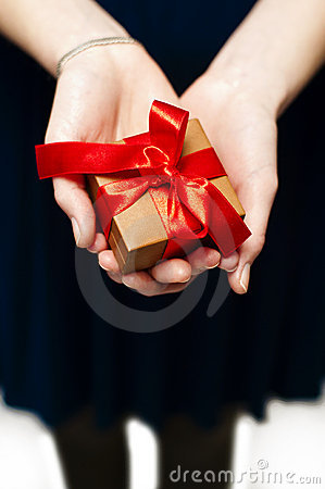 Female hand holding gift box