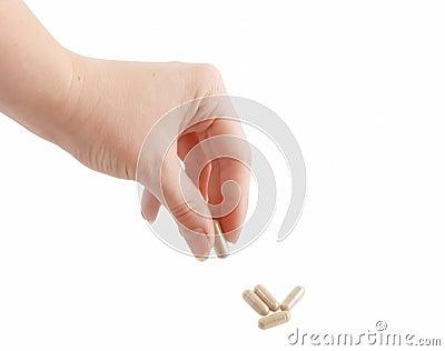 Female hand holding pill
