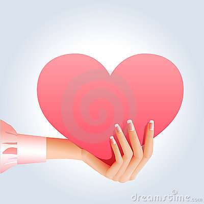 Female hand holding pink heart