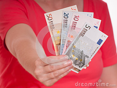 Female hand is holding some euro notes
