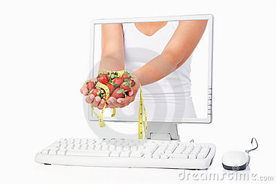 Female hand holding strawberry and measuring tape
