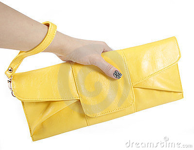 Female hand holding yellow clutch bag