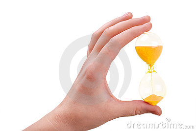 The Female Hand Holds A Sand-glass Royalty Free Stock Images - Image: 18249449