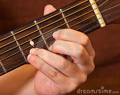 Female Hand Learning Guitar Chord
