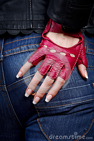 Female hand with manicure in a stylish glove