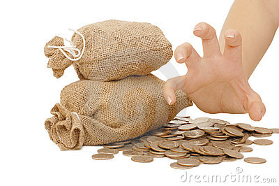 Female hand protects bags with money