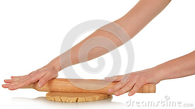 Female hand rolled dough with a rolling pin