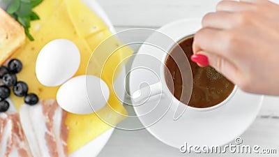 Female Hand Taking Metallic Spoon Mixing Milk In Coffee ...