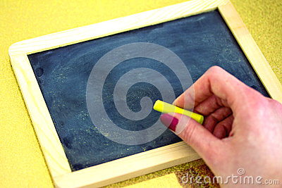 Female hand about to write on blackboard