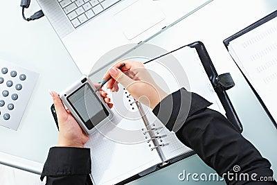 Female hand using PDA