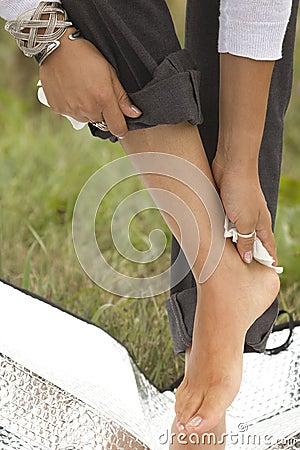 Female hand wiping  feet