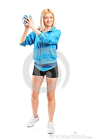 Female handball player holding a ball