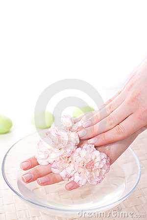 Female hands in bowl full of water