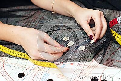 Female hands choosing buttons