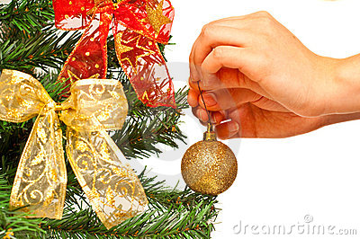 Female hands decorating a christamss tree