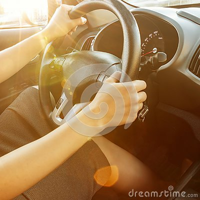 Free Female Hands Hold The Steering Wheel, Close-up. A Woman Is Driving A Car. Stock Image - 109640091