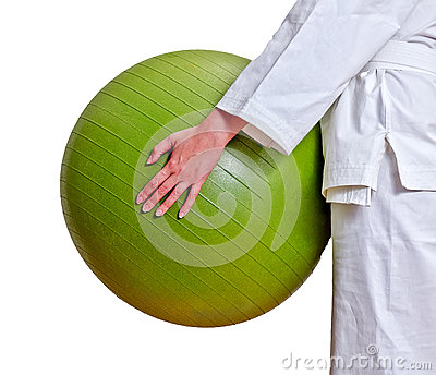 Female hands holding fitball.
