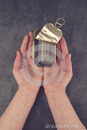 Free Female Hands Holding Open Empty Sardine Fish Tin Can Stock Photos - 52456003