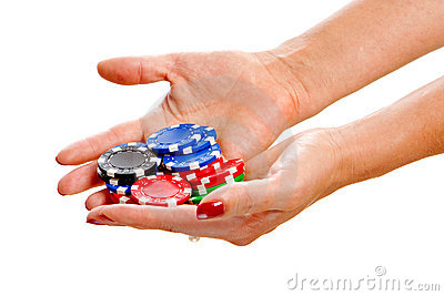 Female hands holding poker chips