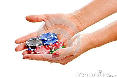 Female hands holding poker chips
