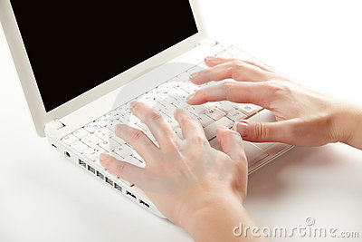 Female hands on a laptop keyboard