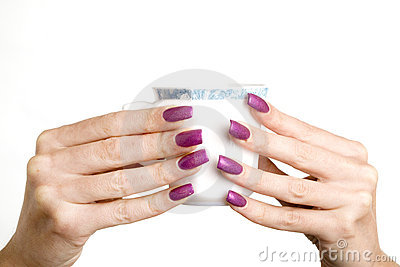 Female hands with long nails with manicure hold