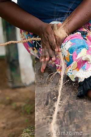 Female hands make a corn from coconut copra fibre