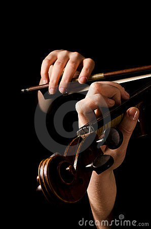 Female hands play a violin
