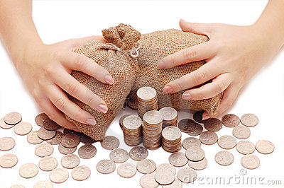 Female hands protects bags with money