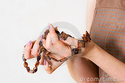 Female hands show beautiful necklace