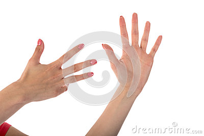 Female hands showing nine fingers isolated on white