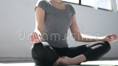 female hands during yoga meditation in lotus pose in